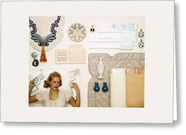 A Woman Sleeping Next To An Assorted Range Greeting Card by Geoffrey Baker