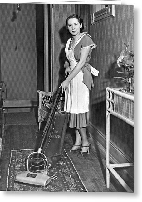 A Woman Vacuuming Greeting Card by Underwood Archives