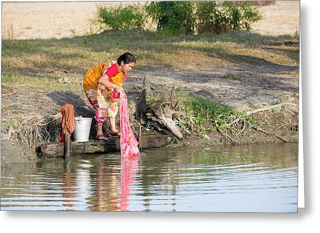 A Woman Washing Clothes Greeting Card