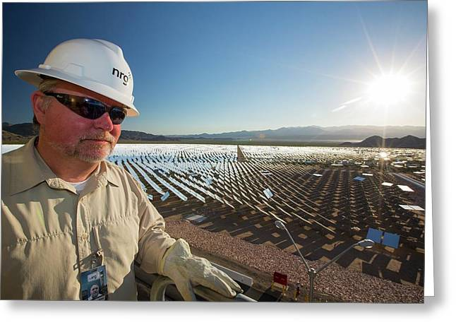 A Worker At The Ivanpah Solar Thermal Greeting Card by Ashley Cooper