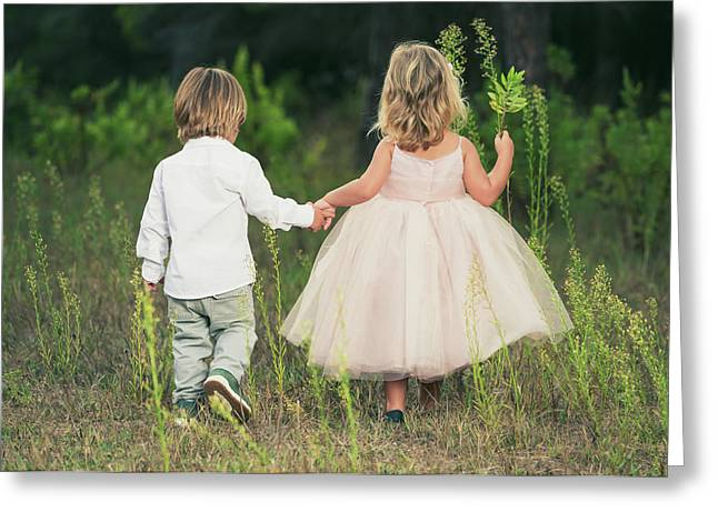 A Young Boy And Young Girl Holding Greeting Card by Ben Welsh