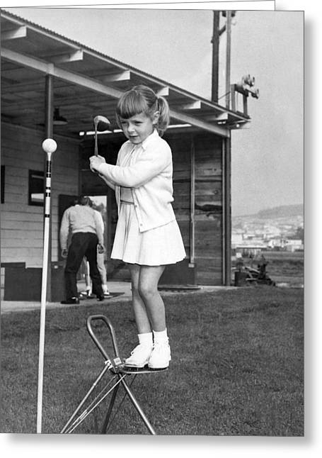 A Young Girl Hits A Golf Ball Greeting Card by Underwood Archives