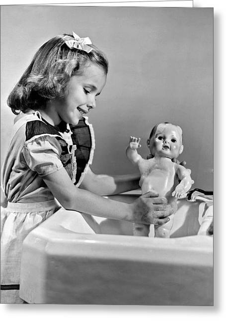 A Young Girl Plays With Her New All-vinyl Plastic Doll That Can Greeting Card