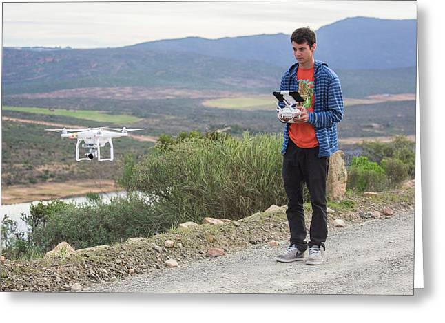 A Young Male Flies His Drone Greeting Card