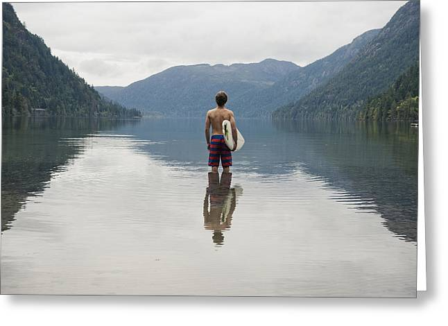 A Young Man Wearing A Swimsuit Stands Greeting Card by Helene Cyr