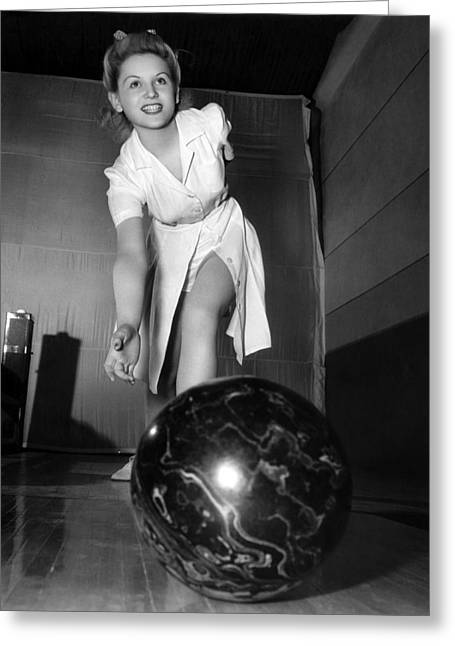 A Young Woman Bowling Greeting Card by Underwood Archives