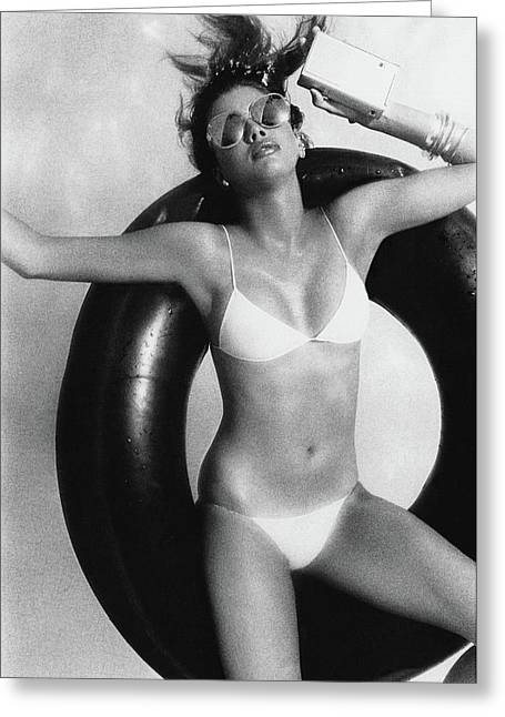 A Young Woman Floating On An Inner Tube Greeting Card by Albert Watson