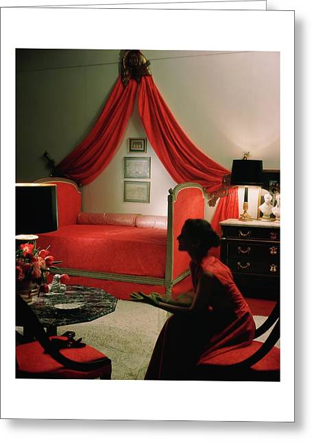 A Young Woman Sitting In A Red Bedroom Greeting Card