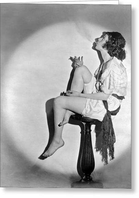 A Young Woman Smoking Greeting Card by Underwood Archives