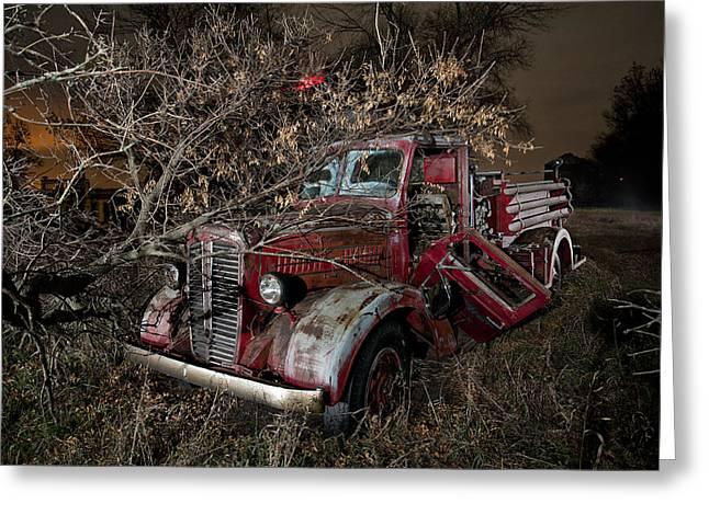 Abandoned Firetruck At Night Greeting Card by Tom Phelan