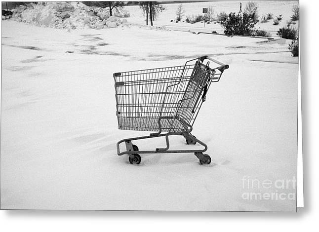 abandoned shopping cart in snow covered supermarket parking lot Saskatoon Saskatchewan Canada Greeting Card