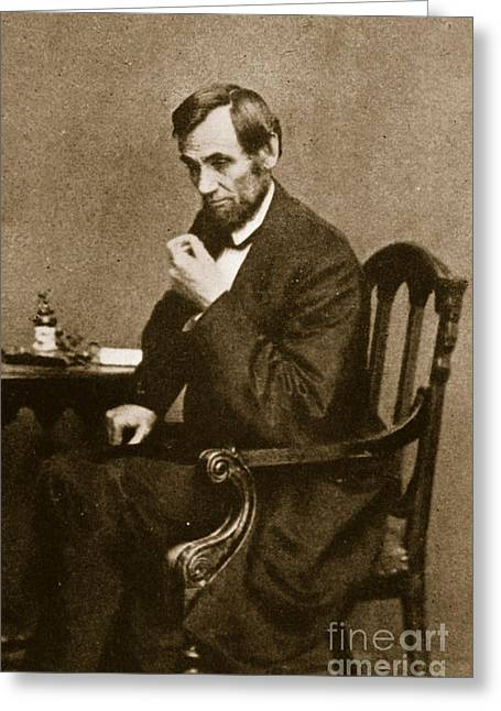 Abraham Lincoln Sitting At Desk Greeting Card