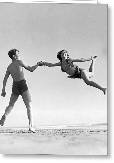 Acrobatic Beach Exhibition Greeting Card by Underwood Archives