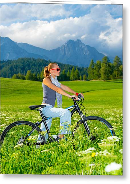 Active Woman On Bicycle In Mountains Greeting Card