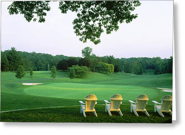 Adirondack Chairs In A Golf Course Greeting Card by Panoramic Images