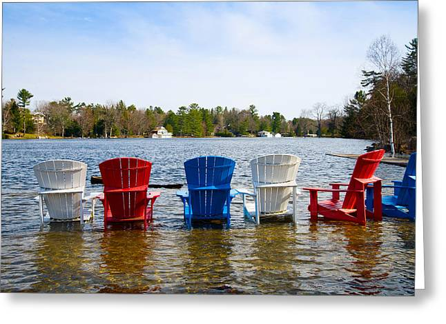 Adirondack Chairs Partially Submerged Greeting Card by Panoramic Images