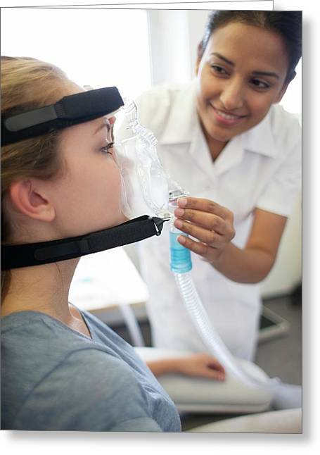 Adjusting Ventilator Mask Greeting Card by Science Photo Library