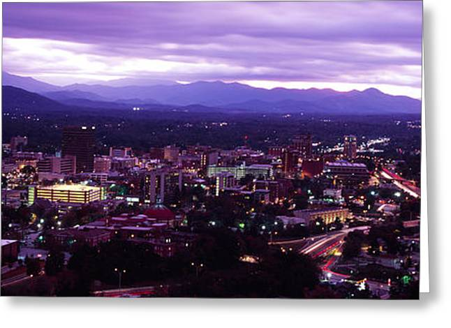 Aerial View Of A City Lit Up At Dusk Greeting Card by Panoramic Images