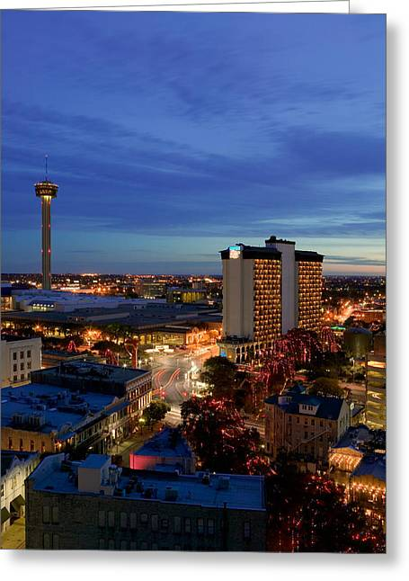 Aerial View Of Buildings Lit Greeting Card by Panoramic Images