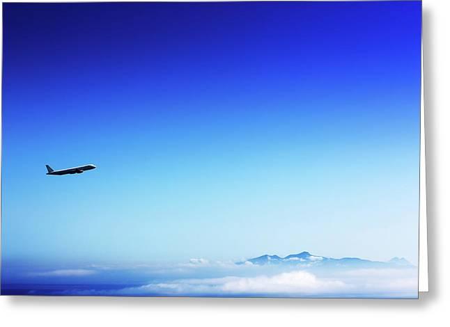 Aeroplane Flying In A Clear Blue Sky Greeting Card by Wladimir Bulgar