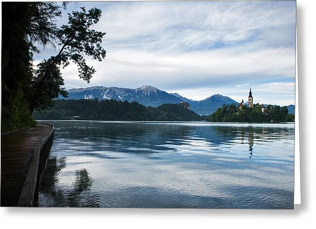 Greeting Card featuring the photograph After Storm Light Over Lake Bled by Ian Middleton