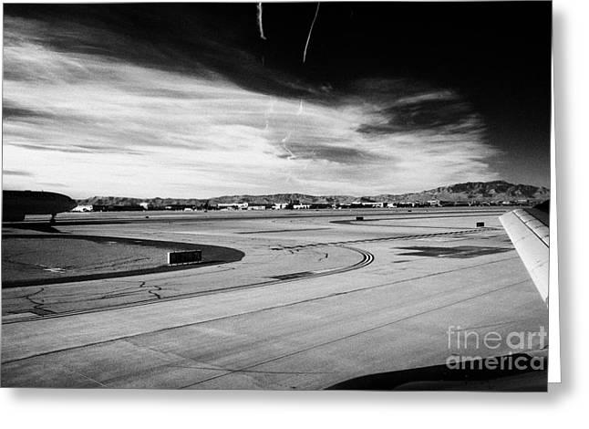 aircraft on runway and taxiway waiting to take off at McCarran International airport Las Vegas Greeting Card