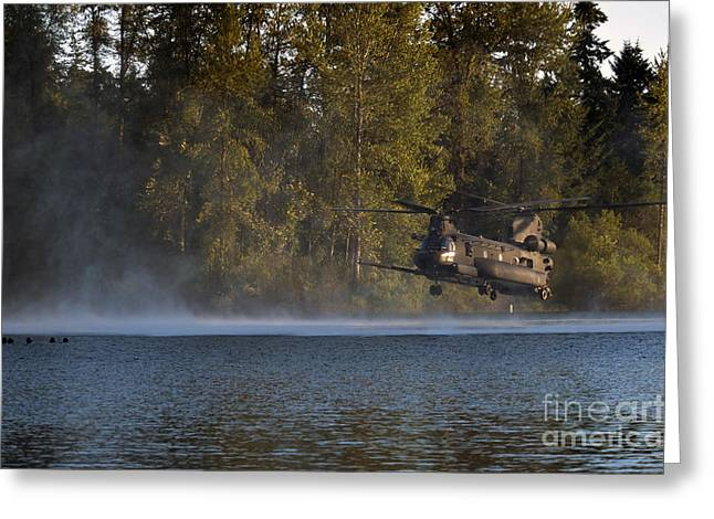 Airmen Wait In A Lake For An Mh-47 Greeting Card by Stocktrek Images
