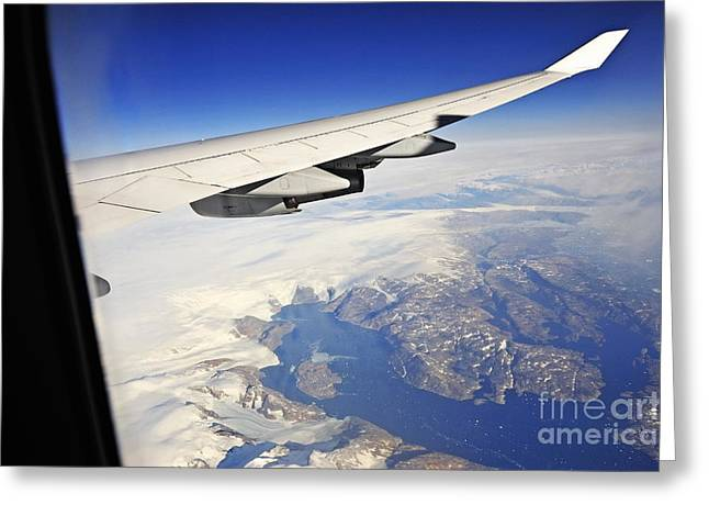Airplane Wing Over Snowy And Rocky Coastline Greeting Card by Sami Sarkis