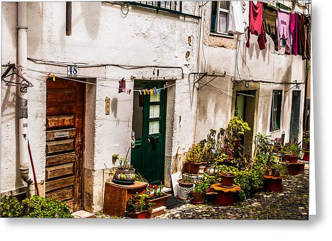 Alfama Houses Greeting Card by Paul Donohoe