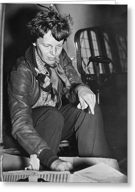 Amelia Earhart Checks Supplies Greeting Card by Underwood Archives