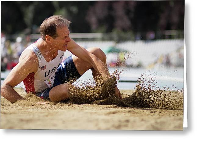 American Senior Competes In Long Jump Greeting Card by Alex Rotas