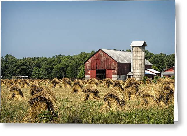 Amish Country Wheat Stacks And Barn Greeting Card by Kathy Clark