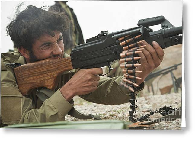 An Afghan Local Police Officer Fires Greeting Card by Stocktrek Images