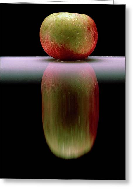 An Apple & Its Reflection In A Polished Table Top Greeting Card by Mike Devlin/science Photo Library