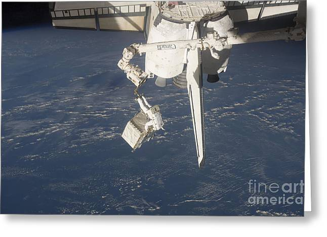 An Astronaut Carries A Pump Module Greeting Card by Stocktrek Images