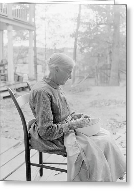 An Elder Woman Cutting Fruit On A Farm Greeting Card by Stocktrek Images