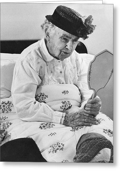 An Elderly Woman With A Mirror Greeting Card