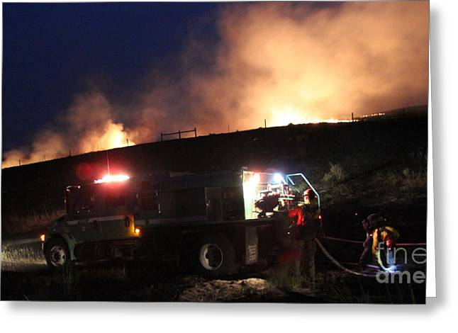 Greeting Card featuring the photograph An Engine Crew Works At Night On White Draw Fire by Bill Gabbert
