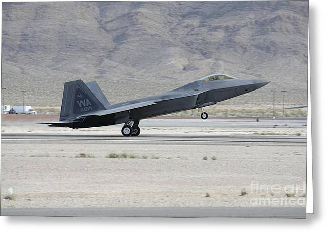 An F-22 Raptor Landing On The Runway Greeting Card by Remo Guidi