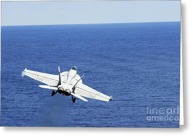 An Fa-18e Hornet Taking Off From Uss Greeting Card by Stocktrek Images