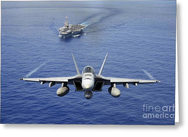 An Fa-18e Super Hornet Flying Above Uss Greeting Card by Stocktrek Images