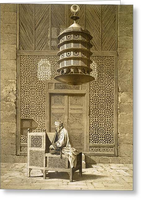 An Imam Reading The Koran In The Mosque Greeting Card by Maurice Keating
