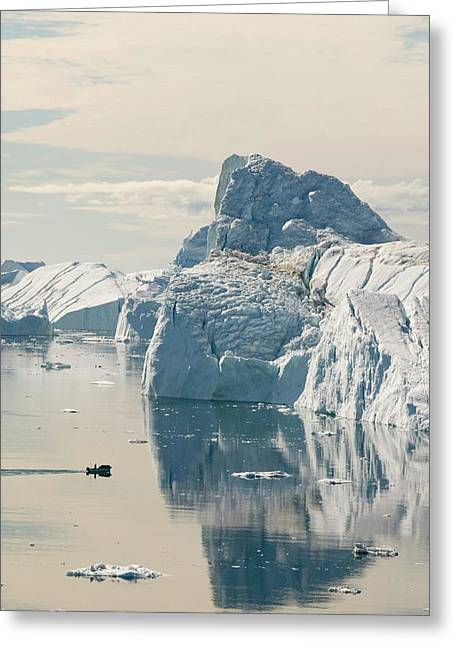 An Inuit Fishing Boat In Icebergs Greeting Card by Ashley Cooper