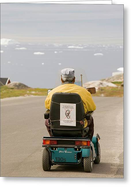 An Inuit Man In A Mobility Scooter Greeting Card