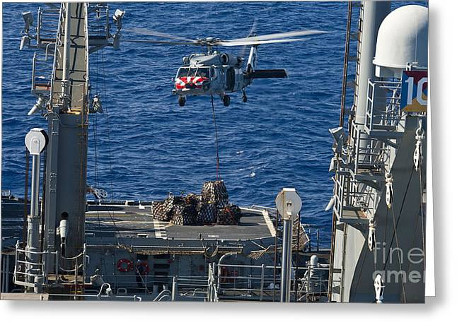 An Mh-60s Sea Hawk Delivers Supplies Greeting Card by Stocktrek Images