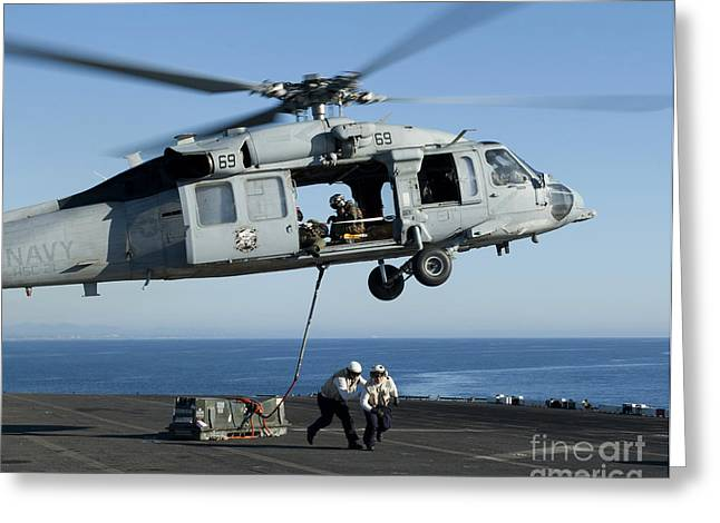 An Mh-60s Sea Hawk Helicopter Prepares Greeting Card by Stocktrek Images