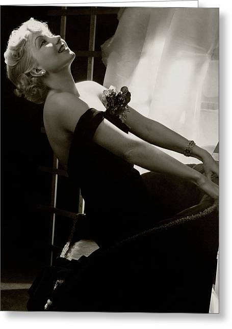 Ann Sothern Kneeling On An Armchair Greeting Card by Lusha Nelson