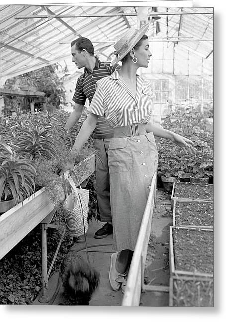 Anne Gunning Parker With A Man In A Greenhouse Greeting Card by Horst P. Horst