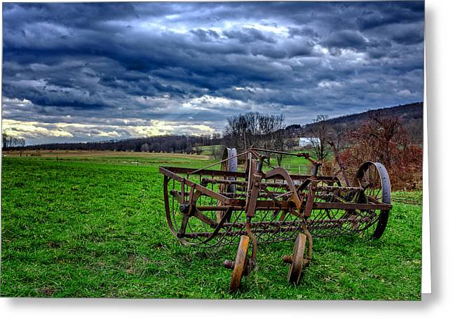 Antique Hay Rake Under As Stormy Sky Greeting Card by Chris Bordeleau