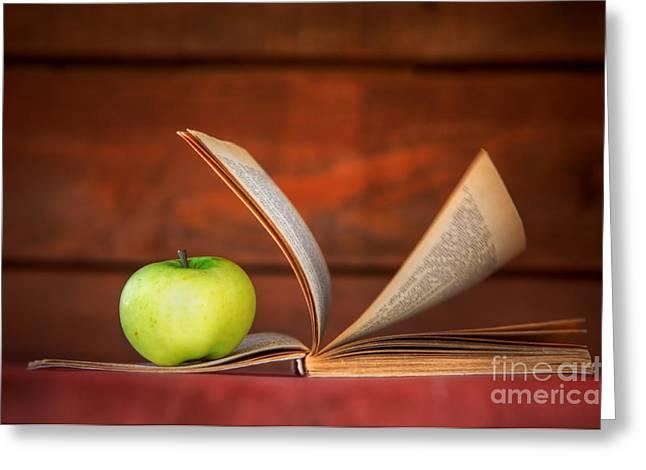 Apple And Book Greeting Card by Michal Bednarek